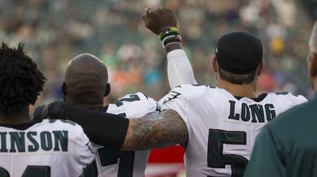 Malcolm Jenkins and Chris Long of the Eagles