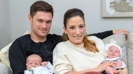 Ashley Boccio and Chris Hogan with their twins,