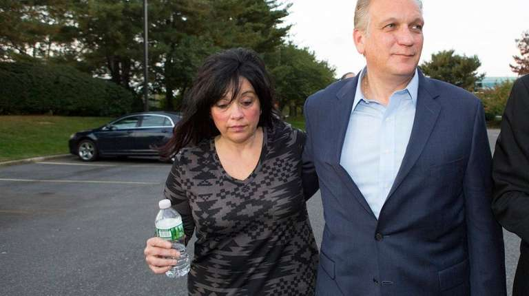 Nassau County Executive Edward Mangano surrenders with his