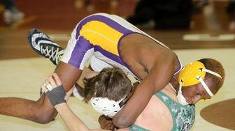 Central Islip's Kwesi Amoa wins against Lindenhurst's Sean