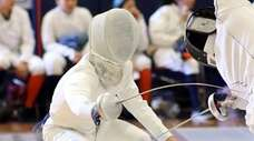 Jericho's Bennett Cohen competes during the Nassau fencing