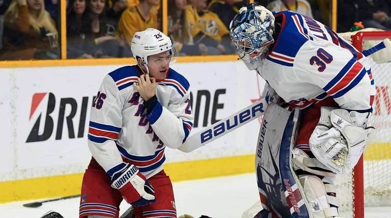 Rangers goaltender Henrik Lundqvist checks on left wing