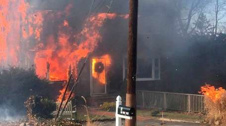 Two Halesite firefighters were injured while battling a