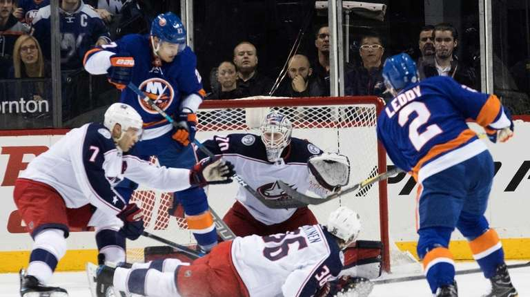 New York Islanders defenseman Nick Leddy (2) scores