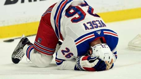 Rangers left wing Jimmy Vesey falls to the