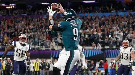 The Eagles' Nick Foles catches a touchdown pass