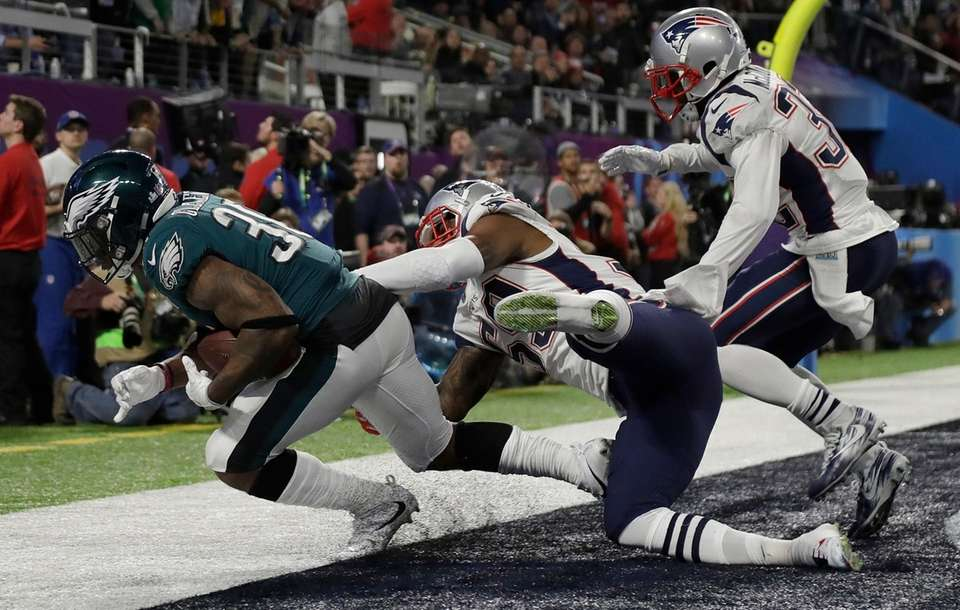 Philadelphia Eagles' Corey Clement catches a touchdown pass