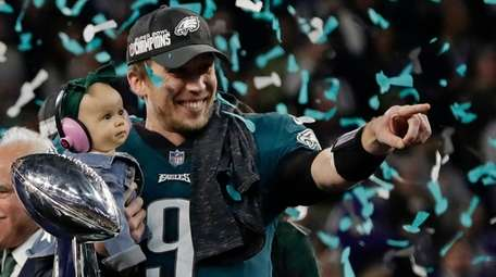 Eagles quarterback Nick Foles holds his daughter, Lily