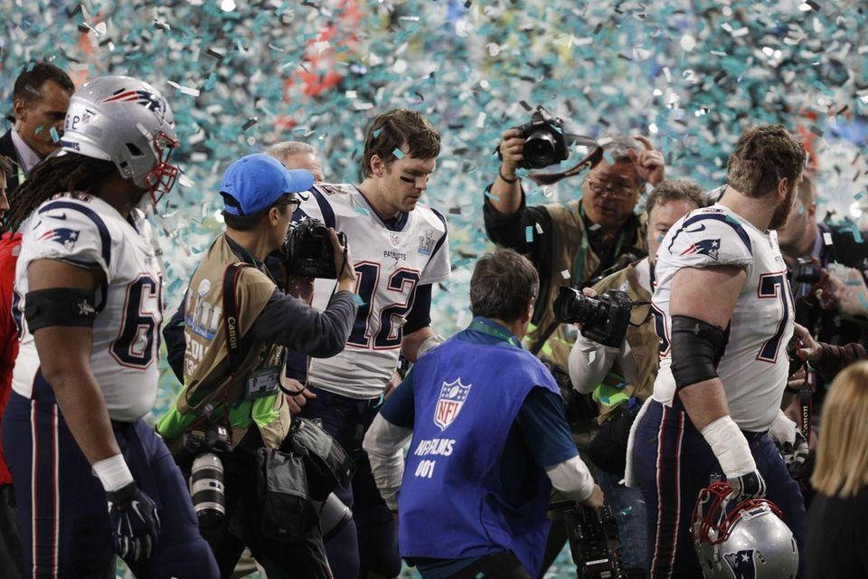 New England Patriots quarterback Tom Brady walks off