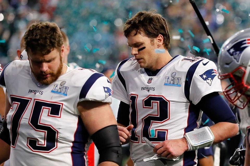 Tom Brady #12 and Ted Karras #75 of