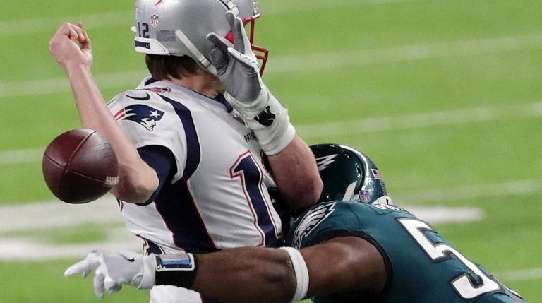 d07b72eb1cc Tom Brady #12 of the New England Patriots. Tom Brady #12 of the New England  Patriots has the ball stripped by Brandon Graham #55 of the Philadelphia  Eagles ...