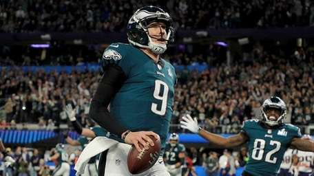 Eagles quarterback Nick Foles reacts after a 1-yard