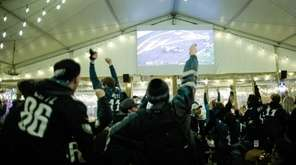 Eagles fans celebrate the second touchdown during the