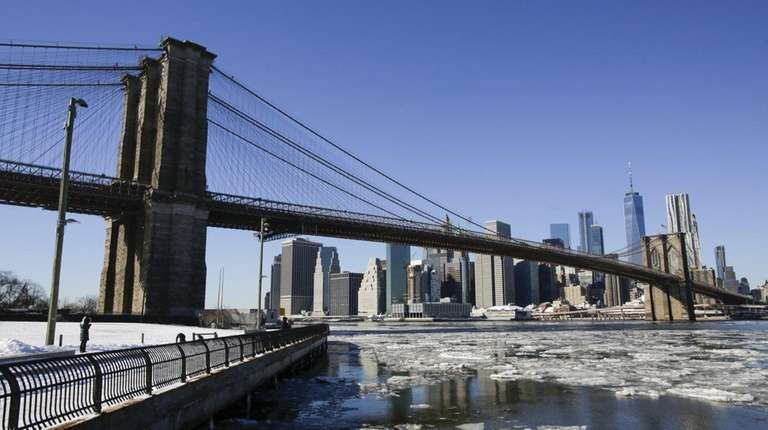 Ice floats along the East River under the