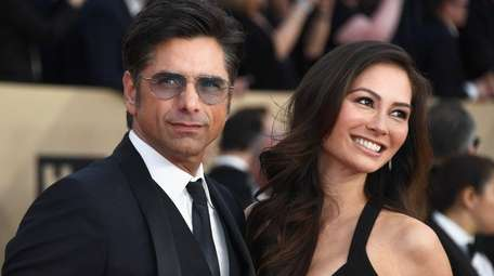 John Stamos and Caitlin McHugh attend the 24th