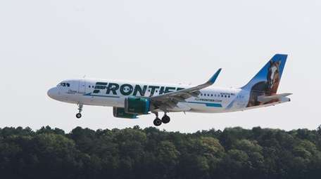 A Frontier Airlines plane lands at Long Island
