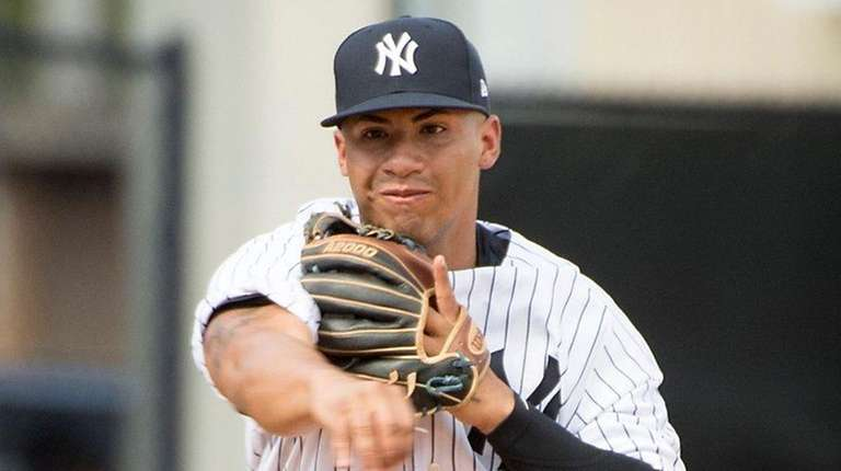The Yankees' Gleyber Torres fields a ball during