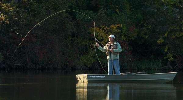 An unidentified man fishes in Oyster Bay, NY,