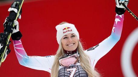 Lindsey Vonn celebrates on the podium after winning