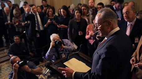 Senate Minority Leader Chuck Schumer (D-N.Y.) talks to