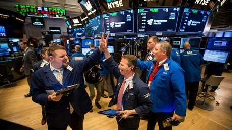 Traders react after the closing bell on the