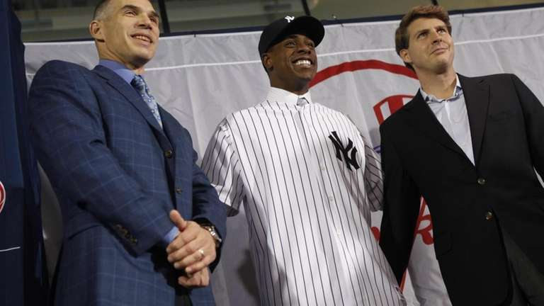 Curtis Granderson, center, the newest New York Yankees
