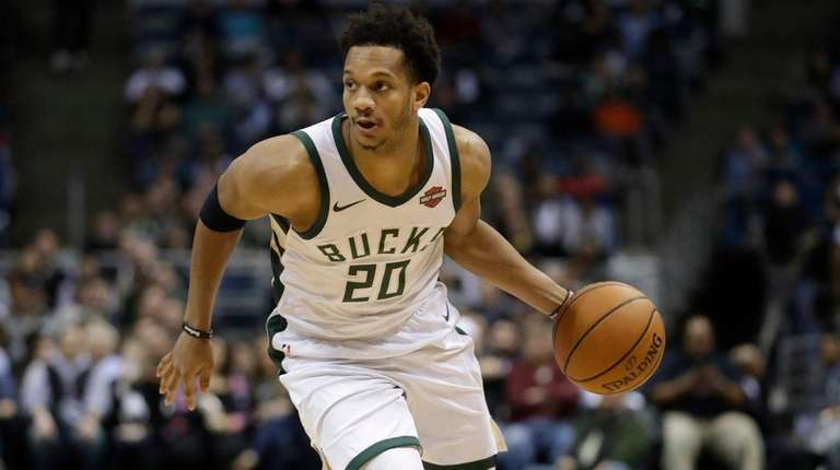 Rashad Vaughn, then with the Bucks, dribbles against