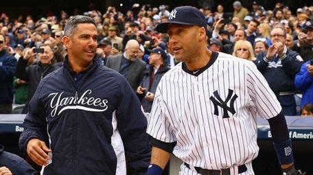 Jorge Posada, left, and Derek Jeter are introduced