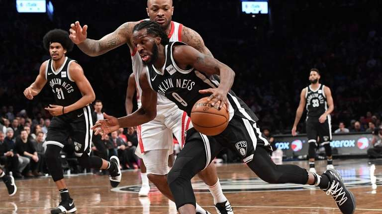 Brooklyn Nets forward DeMarre Carroll drives to the