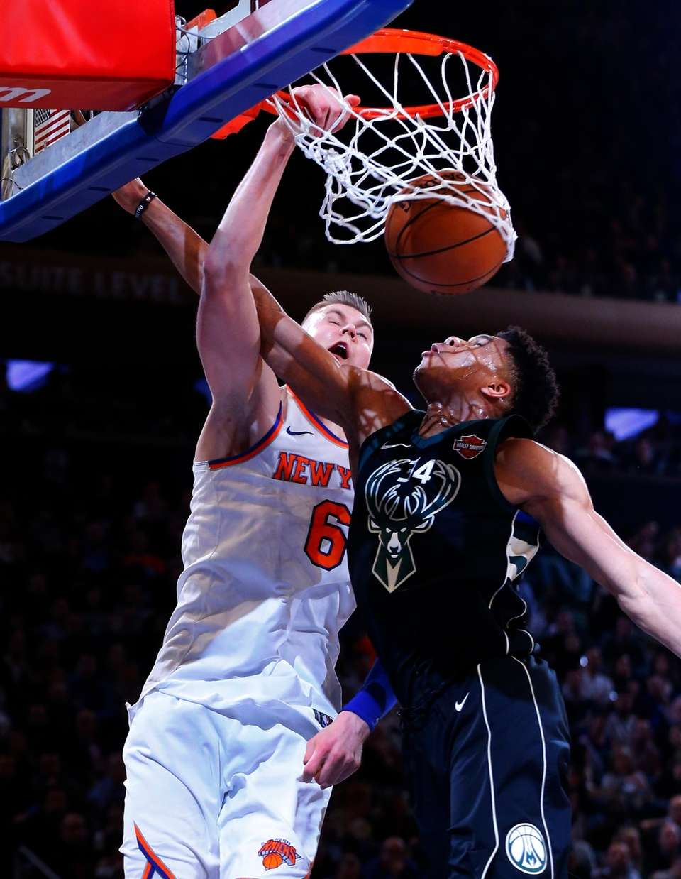 Kristaps Porzingis of the Knicks dunks the ball