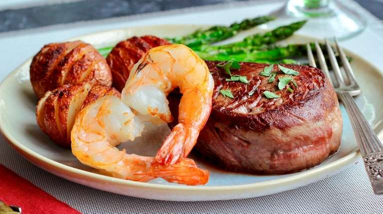 Seared filet mignon steaks, shrimp, Hasselback new potatoes