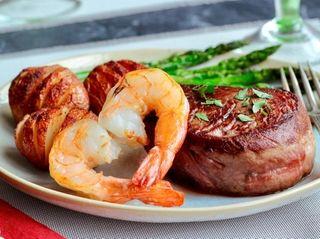 Seared filet mignon steaks, shrimp, Hasselback new potatoes