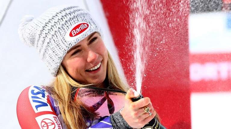 Mikaela Shiffrin celebrates after coming third in an