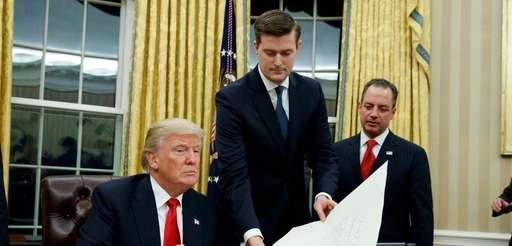 White House Staff Secretary Rob Porter, center, with