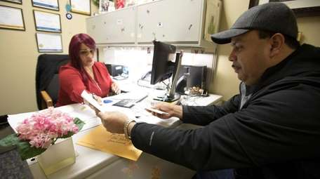 Carrie Roman, left, a bilingual housing counselor, helps