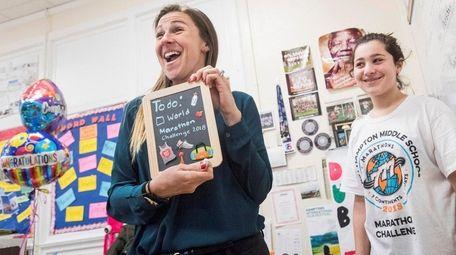 Teacher Cara Nelson shows off a present from