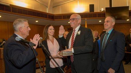 Nassau County Republican Party chairman Joseph Mondello swears