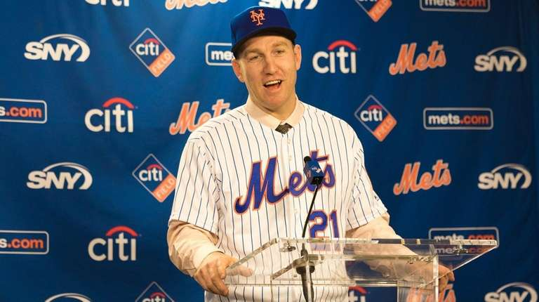 The Mets' Todd Frazier talks to reporters during