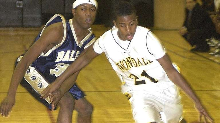 Uniondale's Shaq Mosley, (21, right), drives to the