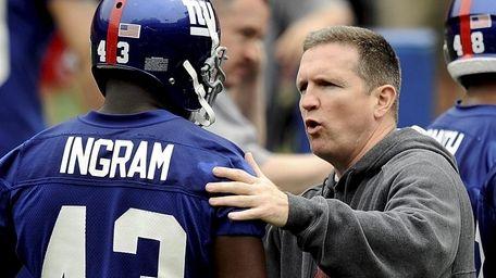 Former Giants fired defensive coordinator Bill Sheridan, right,