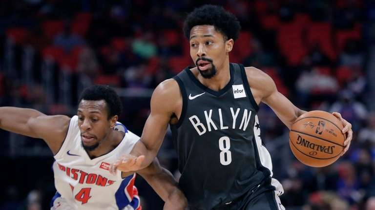 Nets guard Spencer Dinwiddie drives around Pistons guard