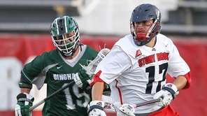 Stony Brook's Ryland Rees brings the ball up