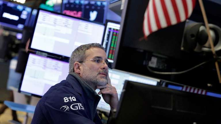 Specialist Anthony Rinaldi works at the NYSE, Wednesday,