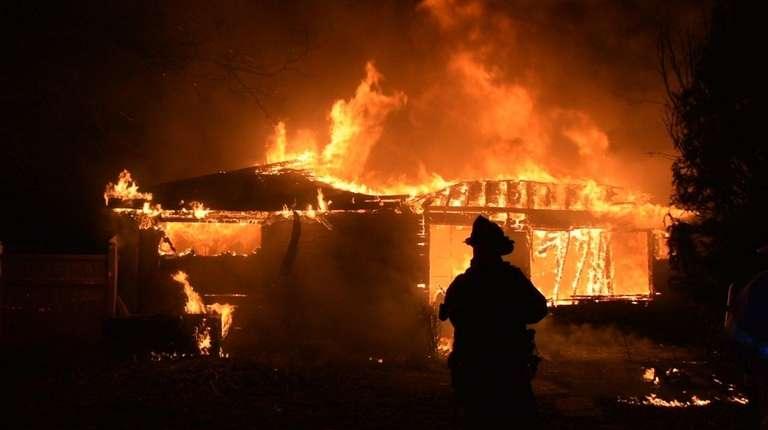 A fire engulfed a vacant house in Copiague