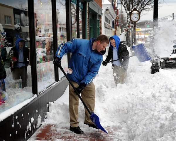 Bart Narracci, left, and Sam DeNunzio shovel the