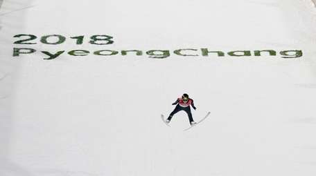 Andreas Wellinger, of Germany, soars through the air