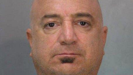 Micah Raskin, 49, of Old Westbury, is accused