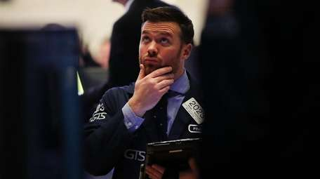 Trader at the New York Stock Exchange moments