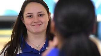 Kellie Sandas of Kellenberg gets congratulated after rolling
