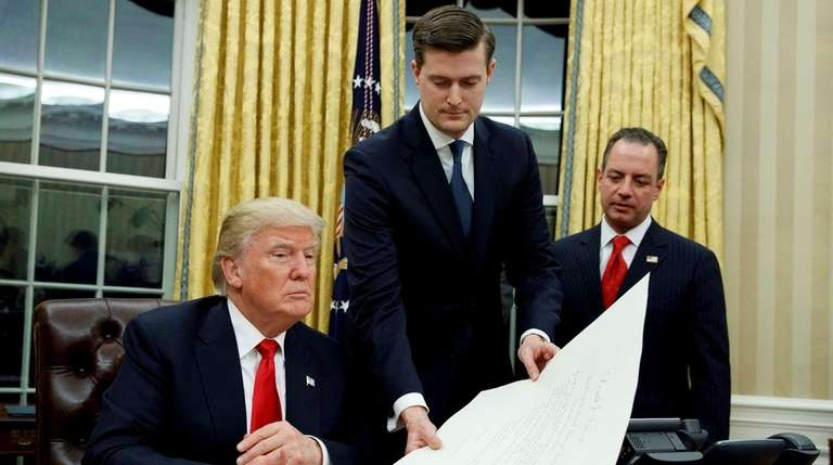 From left, President Donald Trump, Rob Porter and